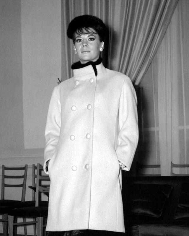 My mom in Paris posing in Yves Saint Laurent, taken in September of 1964.