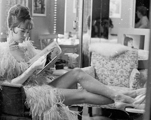 Reading a magazine on the set of the 1962 movie, Gypsy.