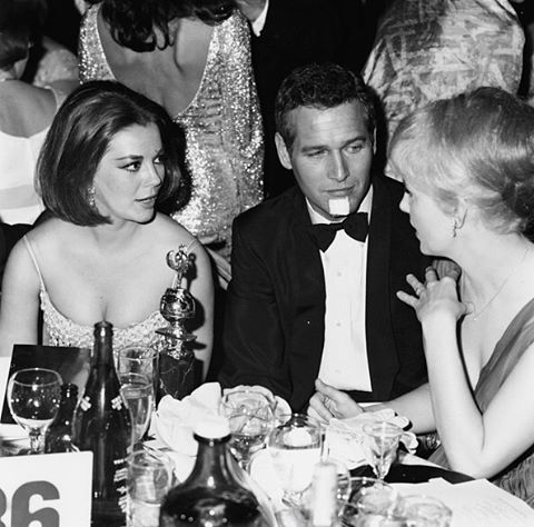Candid of Natalie Wood and Paul Newman at the 1966 Golden Globe Awards.