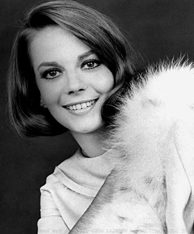 Natalie ahead of the trend wearing a cozy and fuzzy shawl.
