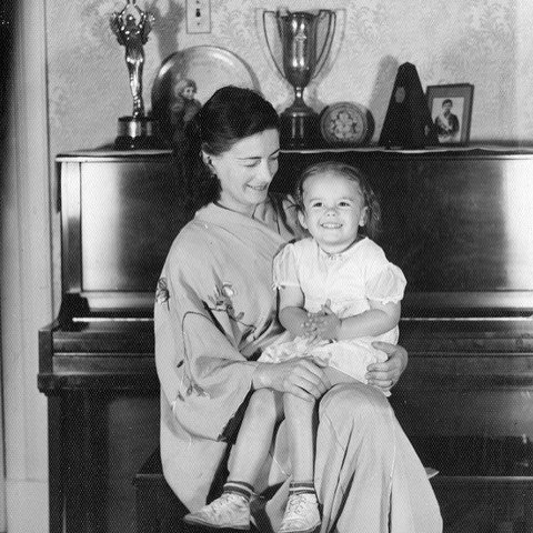 My mama and her mama sitting on our family piano.