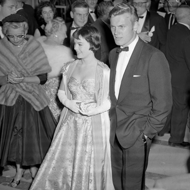 A candid shot of Natalie and Tab Hunter arriving at the 28th Academy Awards!